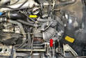 Next, remove the fresh air to turbo supply side boot (red arrow) by using a flathead screwdriver and removing all the hoses attached to it.