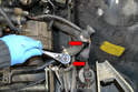 With everything disconnected use a 10mm socket and remove the two 10mm bolts holding the crossover pipe to the frame rails (red arrows).