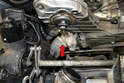 Follow the hose to the coolant pump and remove the clamp and hose from the pump (red arrow).
