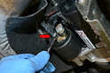Begin by removing the 8mm nut on the starter solenoid (red arrow).