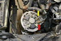 After you have removed the alternator from its mounts, you will need to remove the 8mm nut (yellow arrow) and the 12mm nut (red arrow) and remove the cables from the alternator.