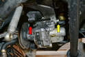 Now completely remove the 13mm nut on the front of the pump (red arrow) and the 13mm bolt on the rear (yellow arrow).