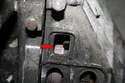 Make sure the engine is set at Top Dead Center (red arrow) and lock the flywheel.