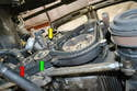 Working from below, you are going to loosen the tensioner (red arrow) and the idler pulley (yellow arrow); the balance shaft pulley is between them (green arrow).