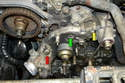 There are three types of fasteners on the pump: a long bolt (red arrow), regular bolts (yellow arrow) and nuts and washers (green arrow).
