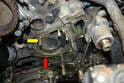 Before installing a new pump, make sure to clean all the old gasket and any dirt or debris from the mounting surface (red arrow).