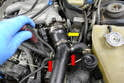 Use a flathead screwdriver and remove the clamp on the tube to intercooler.
