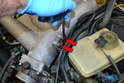 Next, remove the 10mm bolt holding the dipstick tube (red arrow) to the manifold.