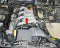 The idle speed adjuster is located under the intake manifold (red arrow) and cannot be replaced with the manifold on.