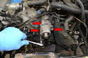 With the Woodruff key removed use a 13mm socket and remove the three bolts holding the mount to the block (red arrows).