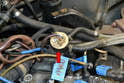 With the manifold removed you can see the cycling valve (red arrow) at the rear of the motor beside the number four spark plug.