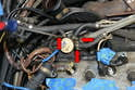 Use a flathead screwdriver and remove the hose clamps and hoses from the valve (red arrows).