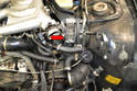 The bracket that holds the turbo coolant pump (red arrow) also assists in holding the heat shield in place.