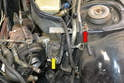 There is a 10mm bolt behind the turbo coolant pump (yellow arrow) that you must carefully remove and make sure it does not fall back into the engine area.
