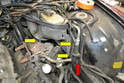 Remove the 10mm bolt hold in the A/C lines (red arrow) and slip the coolant pump bracket out.