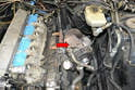 With everything removed you should be looking at a bare turbo on the left side of the engine (red arrow).