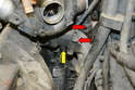 Remove the two 10mm bolts and the shield for the steering knuckle (red arrows, shield already removed).