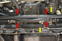 Remove the four 13mm bolts holding the steering rack in place as well as the single 10mm bolt holding the line and ground cable (yellow arrows).