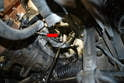Use a 6mm Allen, universal joint and long extension to shock the bolt by first hitting the extension with a hammer to help loosen the bolt and then remove the short mounting bolt on the underside of the turbo (red arrow).