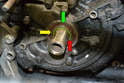 This photo illustrates the O-ring (red arrow), oil pump gear (yellow arrow) and the oil seal (green arrow).