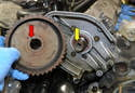 Slide the sprocket (red arrow) off the end of the camshaft (yellow arrow).