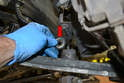 There is a washer (red arrow) and bushing on the top of the control arm.