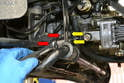 Use two 13mm sockets or wrenches and remove the two nuts (red arrows) and bolts (yellow arrows) from the mounting brackets.