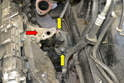 With the turbo removed, you can see the engine support on the left side of the motor (red arrow) and how it attaches to the mount (yellow arrows).