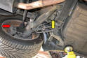 The rear brake lines on the 944 have a hard line going into the caliper (red arrow) and the flexible connecting line is located up under the trailing arm (yellow arrow).