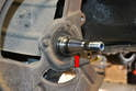 Clean all the grease off the spindle (red arrow) and check it for wear as well.