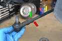 Measure and mark the installation position of the outer tie rod end (red arrow) or count the turns when removing.