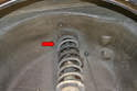 Go back to the top of the strut tower and complete removing the four 13mm nuts and washers.