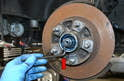 You will need to remove the brake rotor to replace the spindle so please see our article on brake rotor replacement for further information.