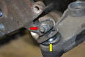 The spindle is held to the control arm ball joint by a 17mm nut and bolt that sits in a groove in the joint.