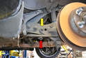 Do not remove the nut (yellow arrow) on the outside of the trailing arm that the drop link (red arrow) connects to.