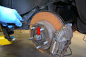 If the rotor will not spin freely you may need to release the parking brake pads on the inside of the rotor.