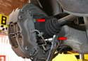 Use a 19mm socket and remove the two caliper mounting bolts (red arrows).