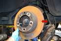 The parking brake shoes are located under the bell of the rear brake rotors (red arrows).