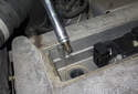 Using a 5/8-inch thin-wall spark plug socket on a 12-inch extension, remove the spark plug from the cylinder head.
