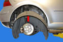 Slip the liner (red arrow) in away from the fender lip and lower it out of the car.