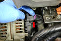 With the alternator free you need to remove a few things from the back before you can remove it from the engine compartment.