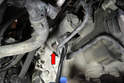 Move back under the car and remove the lower starter bolt.