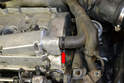 Disconnect the breather hose (red arrow) from the left side of the valve cover.