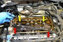 Remove both the outer gasket (red arrows) and the inner spark plug gasket (yellow arrows).