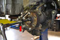 By removing the tie rod end and the ball joint the hub now has enough room to move forward while pressing the axle out.