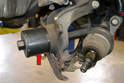 You should now be able to use a bearing puller (red arrow) to remove the bearing.
