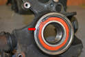 With the bearing fully seated install the new circlip (red arrow).