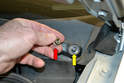 Remove the 13mm nut (red arrow) securing the arm to the mounting shaft (yellow arrow).