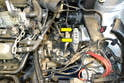 With the engine and transmission safely supported remove the two 18mm transmission mounting bolts (yellow arrows).