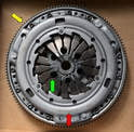 The new clutch assembly or kit comes with the flywheel and starter ring (yellow arrow), the pressure plate (red arrow) and clutch already together and with the installation access holes lined up (green arrow).